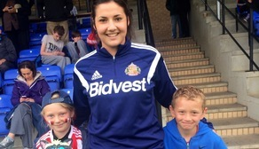 Lauren Briggs and young fans