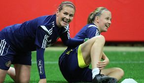 Kelly McDougall and Beth Mead having fun in training