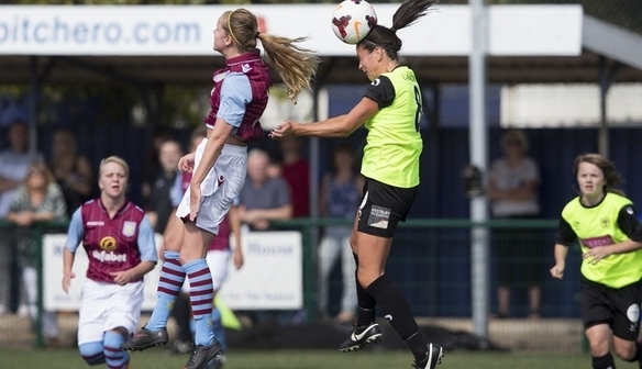 Alicia Robinson battles in the air against Yeovil