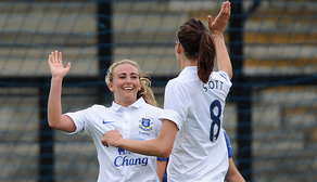 Toni Duggan celebrates with Jill Scott