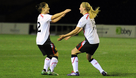 Ellie Stewart celebrates her late winner with Becky Easton