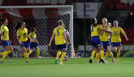 CELEBRATIONS: The team celebrate with goalscorer Emily Simpkins against Reading