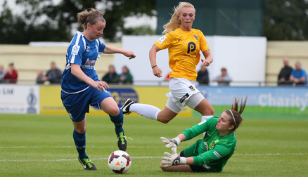 Demi Lambourne gets down to stop the ball