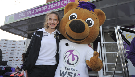 Ash Plumptre and FA WSL mascot Berry the Bear