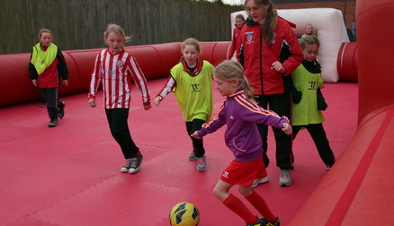 Play on the FREE 5-a-side inflatable football pitch