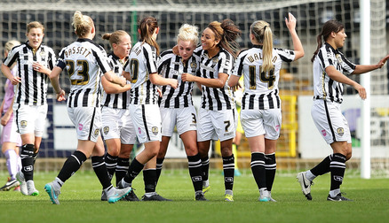Alex Greenwood is mobbed by team mates after the last minute winner