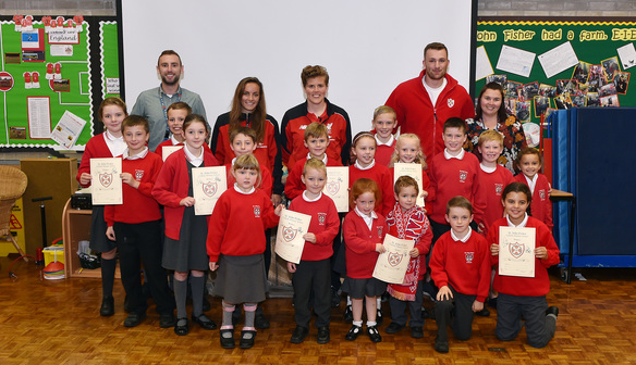 Reds quartet visit local schools to hand out free tickets