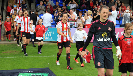 Lumley Ladies players as mascots