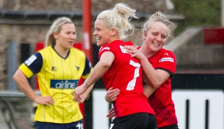 Celebrating a goal v Oxford United with Sherry McCue